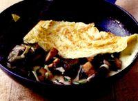 Omletă cu brânză cheddar şi ciuperci
